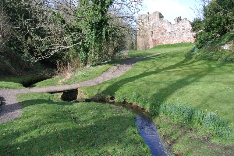 A small stream running in front of Hailes Castle ruin.