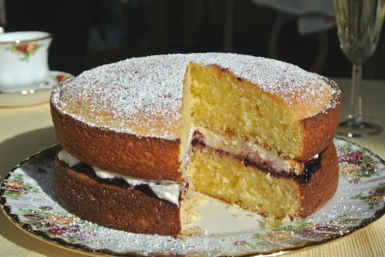 A Victoria Sponge that has been sliced.