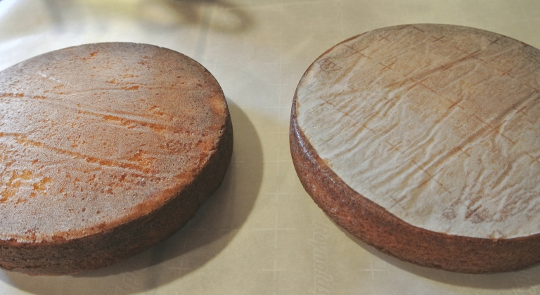Two round cakes ready to be assembled into a Victoria Sponge.