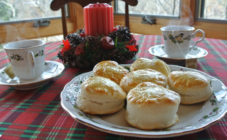 Scones on a table decorated for Christmas.