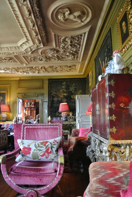 An ornately carved ceiling and bold furnishings at Prestonfield House.