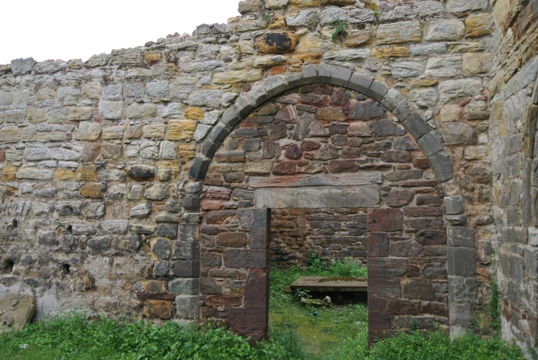 An arched wall in a chapel.