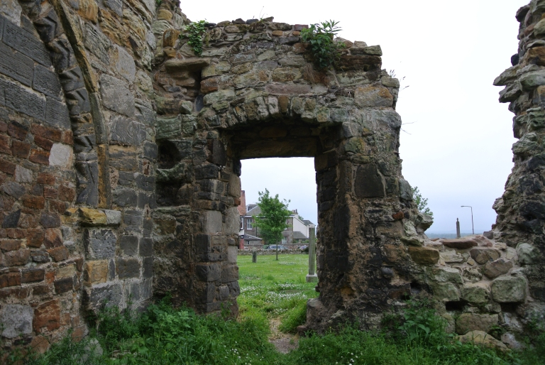 A door in a ruined kirk.