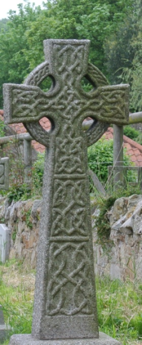 A tall Celtic cross grave marker.