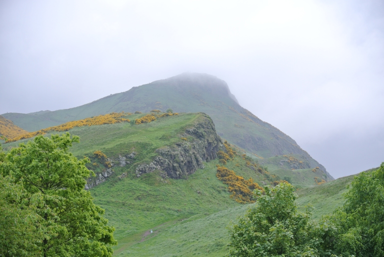 A rocky, gorse covered hill in Holyrood Park.