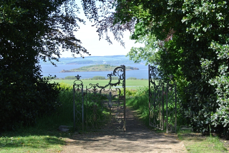 The Firth of Forth beyond a garden gate.