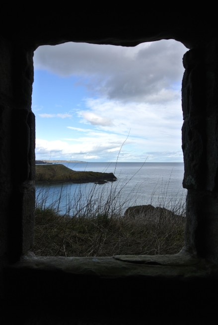 A castle window that overlooks Scotland's North Sea coast.